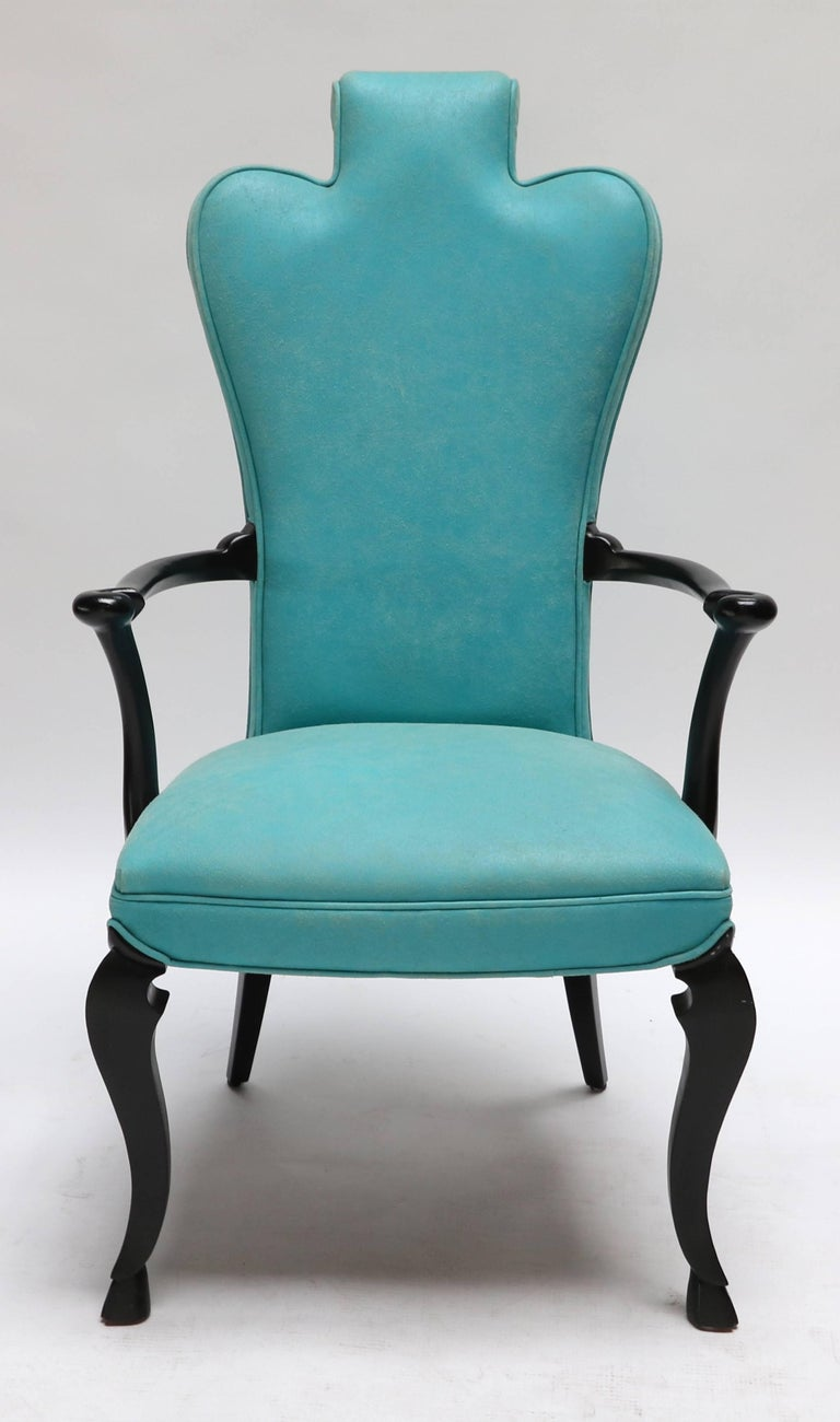 Pair of custom black lacquer armchairs from Adesso Studio upholstered in turquoise distressed leather.