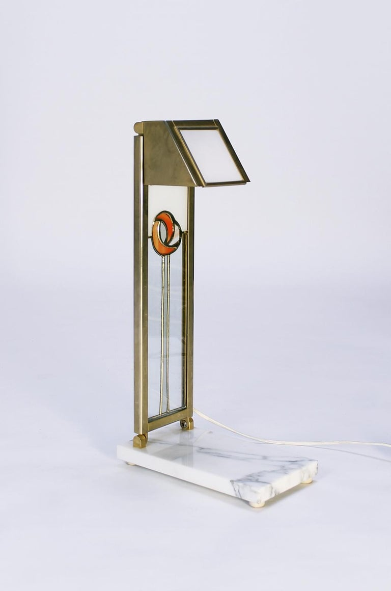 This unique vintage desk lamp is inspired by the Glasgow Art School and features Charles Rennie Mackintosh design elements. It can be adjustable in several directions. Opal glass and brass plates on faux marble basis. Original wiring. It takes a