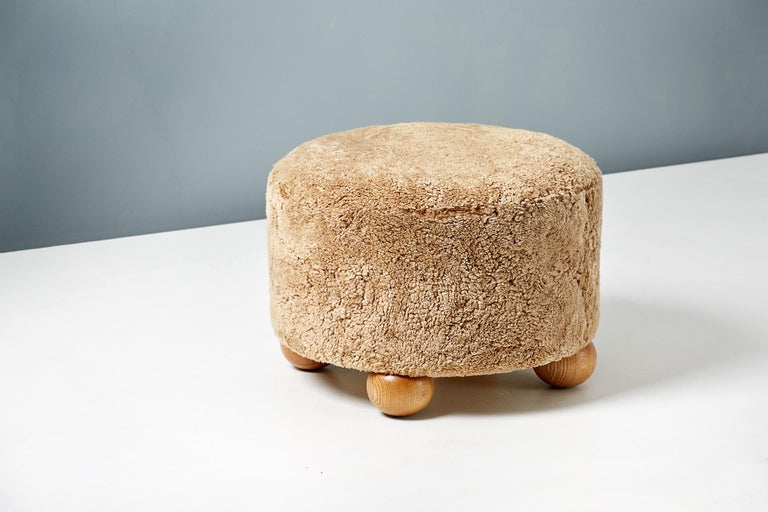 Scandinavian Modern Pair of Custom Made Round Sheepskin Ottomans with Oak Ball Feet For Sale