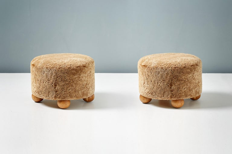 British Pair of Custom Made Round Sheepskin Ottomans with Oak Ball Feet For Sale