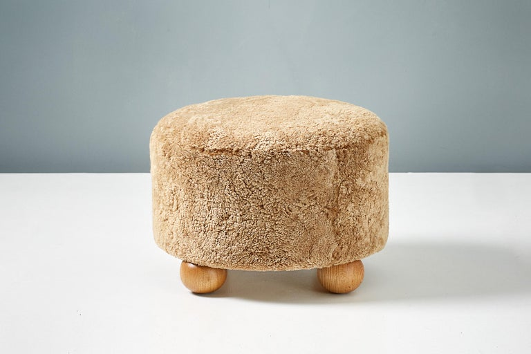 Pair of Custom Made Round Sheepskin Ottomans with Oak Ball Feet For Sale 1