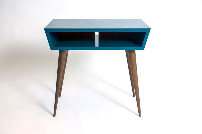 Elegant and unique pair of nightstands, custom made in California nicely blue lacquer case with gold leaf accent design on top solid walnut tapered legs with V-top on the back for lamp cord, solid and sturdy great quality one of a kind piece.