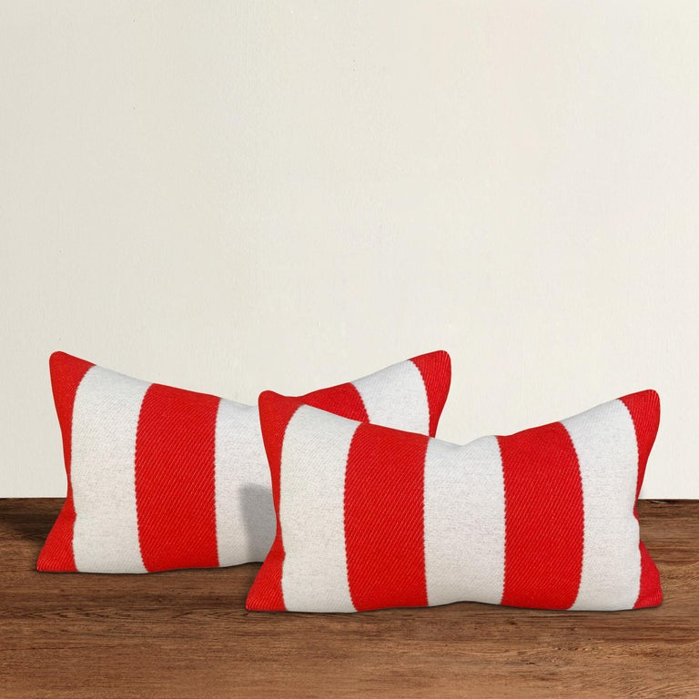 A wonderful pair of lumbar pillows with wide red and white stripes on one side, and solid blue on the other, custom made from wool sourced from the Faribault Woolen Mills in Faribault, Minnesota. Faribault Woolen Mills was founded in 1865 along the