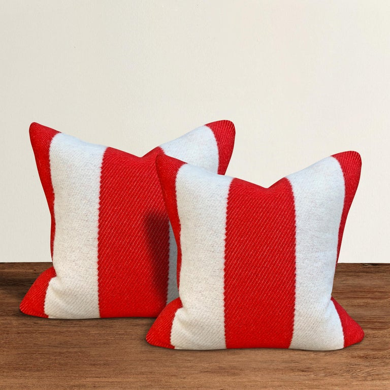 A wonderful pair of pillows with wide red and white stripes on one side, and solid blue on the other, custom made from wool sourced from the Faribault Woolen Mills in Faribault, Minnesota. Faribault Woolen Mills was founded in 1865 along the Cannon