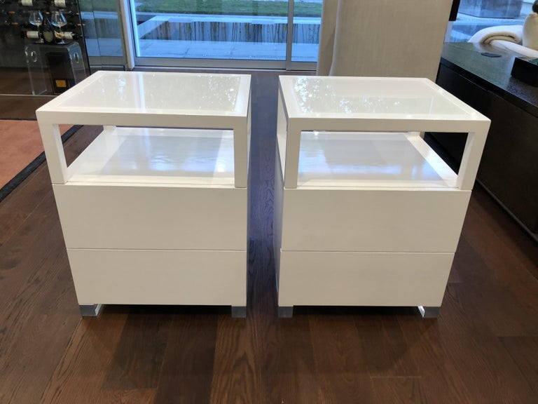 The price is per set of 2 nightstands. Beautiful pair of nightstands made of solid white oak and Lucite with a transparent Lucite tops. The pieces have beautiful lines and great presence, they are solidly built and crafted locally. The nightstands