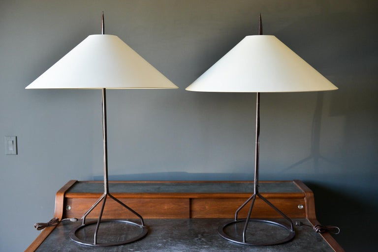 Pair of custom wrought iron lamps with shades, circa 1980. Beautifully handmade wrought iron lamps with custom shades and finials. Original wiring. Large scale, measures 42