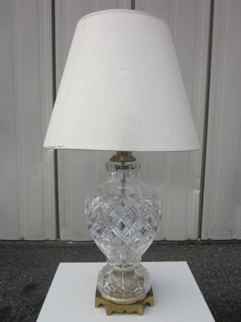 Stunning pair of cut crystal table lamps with brass decorative bases.