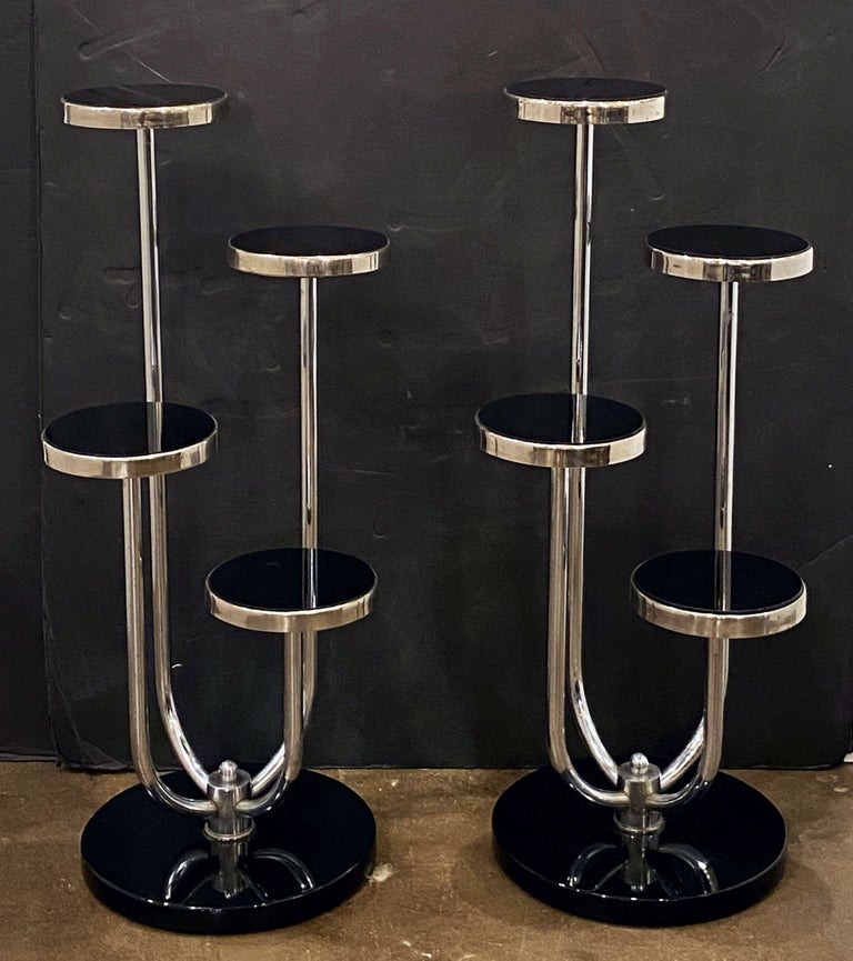 A fine pair of modernist étagères (or plant stands) or decorative tables from the Art Deco period by the celebrated furniture producer, Slezákovy Závody.  Designed by Jindrich Halabala, a proponent of functionalism.  Featuring four tiers of