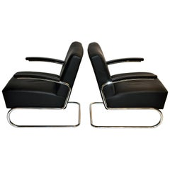 Pair of Czech Chairs with Curved Chrome Legs