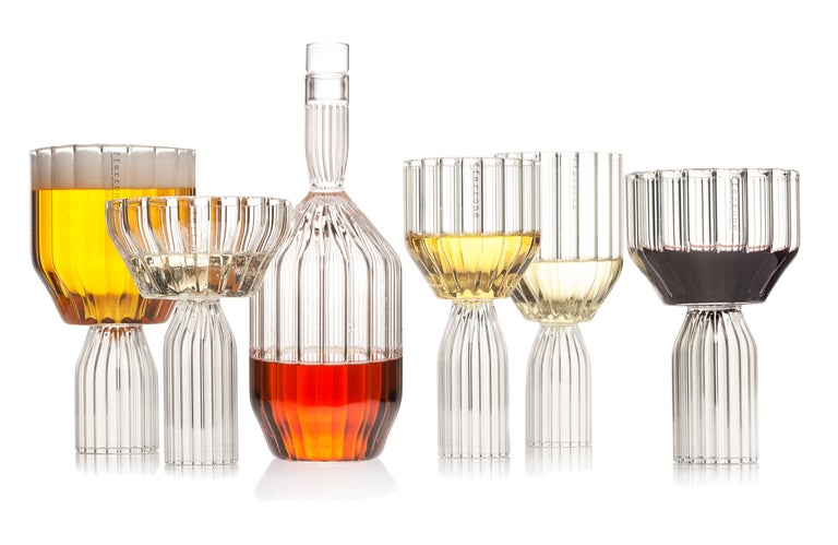 A pair of Czech contemporary glass handcrafted is the perfect large goblet wine or cocktail glass for drinks. Excellent for any drink or water glass.  The modern take on cut-glass, the Margot collection inverts tradition with intricate detail on