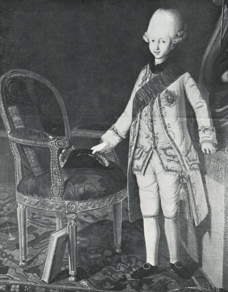 Each with an oval padded back above a large oval drop-in seat, both covered in striped woven silk and flanked by carved scrolled and padded arms, the apron carved with a Vitruvian scroll and paterea, above fluted turned legs terminating in ball