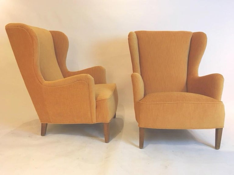 Pair of Danish 1930s-1940s wing chairs newly upholstered in yellow velvet.