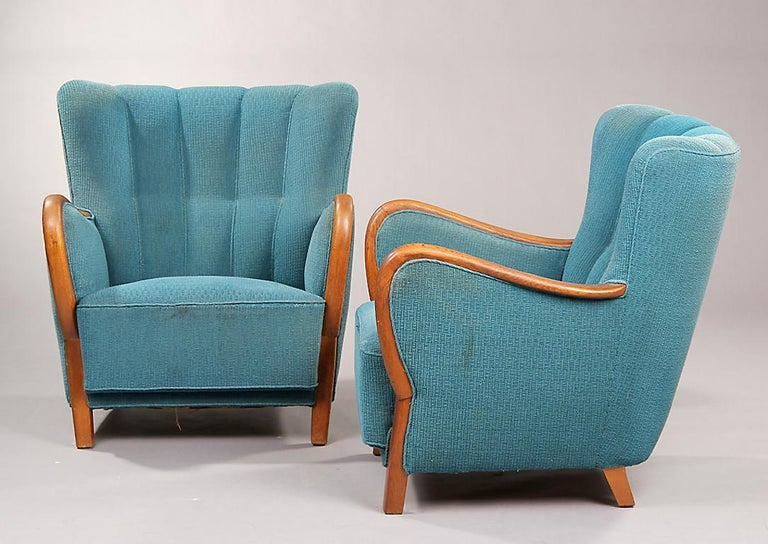 Pair of Danish oak armchairs with closed wood frame arms, circa 1940s.