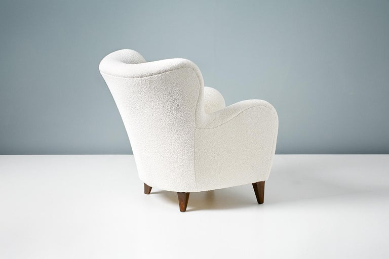 A pair of Danish cabinetmaker 1940s lounge chairs reupholstered in luxurious cotton-wool blend off-white bouclé fabric from Chase Erwin in England.