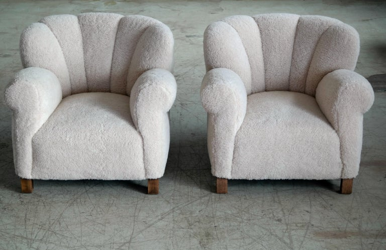 Pair of sublime large scale pair of model 1518 lounge club chairs made by Fritz Hansen in the late 1930s or early 1940s. This model came in two heights - this being the low back model which is quite rare. Superbly comfortable the chairs with their