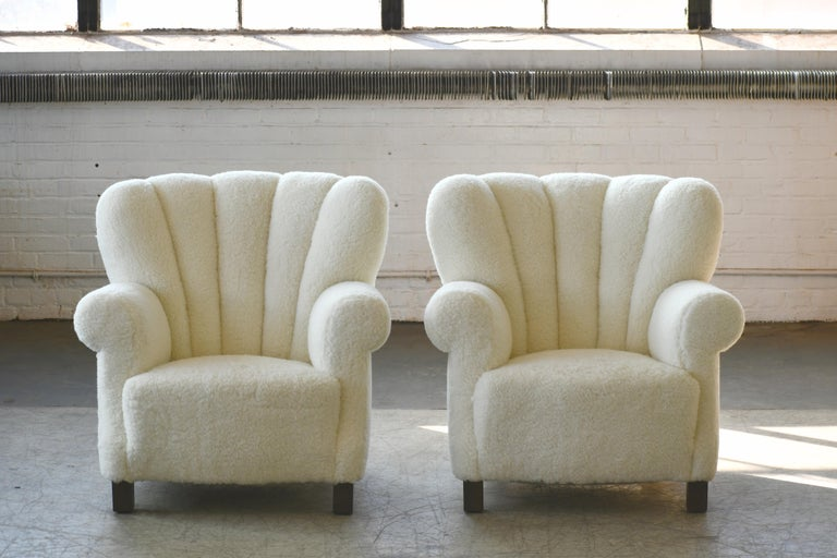 Fantastic large scale pair of club chairs similar to Fritz Hansen's famed model 1518 club chairs from the early 1940s. Slightly smaller than the Hansen chair but superbly comfortable with their low and wide proportions. Strong charming presence to