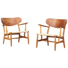 Pair of Danish Lounge Chairs by Hans J. Wegner for Carl Hansen CH 22 Oak
