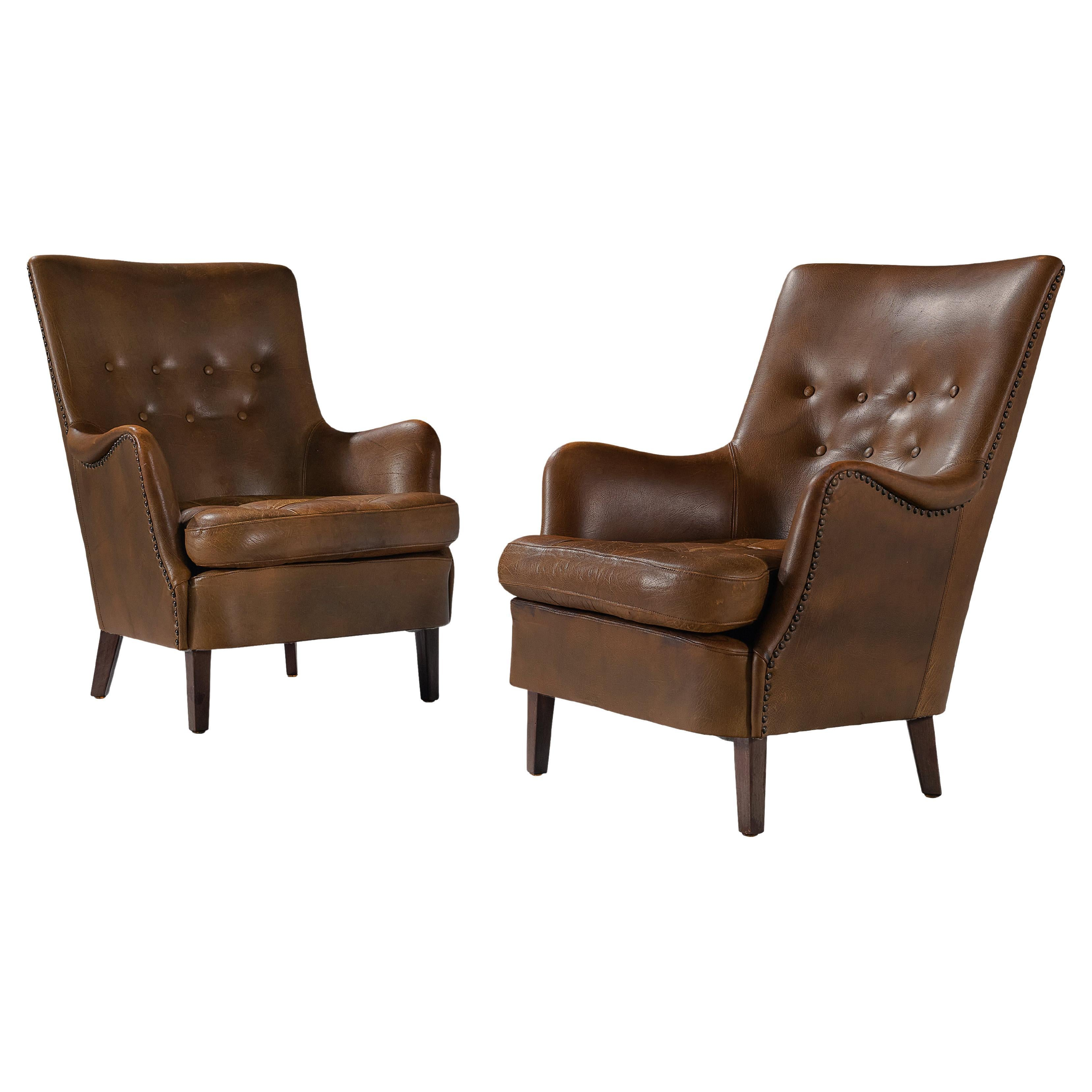 Pair of Danish Lounge Chairs in Patinated Brown Leather
