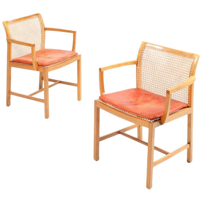Pair of Danish Midcentury Armchairs in Mahogany and Patinated Leather