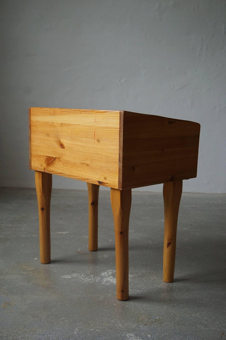 Pair of Danish modern night stands with drawers in solid pine, 1970s  The night stands are nicely patinated and in a good vintage condition.