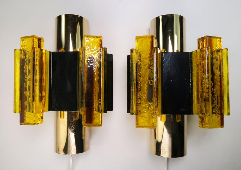Set of two handmade Danish midcentury Space Age modernist wall lights by Danish designer and flight engineer, Claus Bolby. Manufactured by CeBo Industri in Jutland in the 1970s. Yellow rectangular acrylic resin sticks creating sculptural decoration