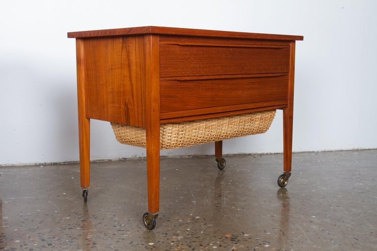 Vintage Danish nightstands with two drawers and draw out woven basket. Originally used as sewing trolleys, but are ideal as bedside tables. Matching pair. Great grain and color. Perfect for vintage bedroom decor.