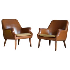 Pair of Danish Midcentury Space Age Lounge Chairs in Teak and Naugahyde