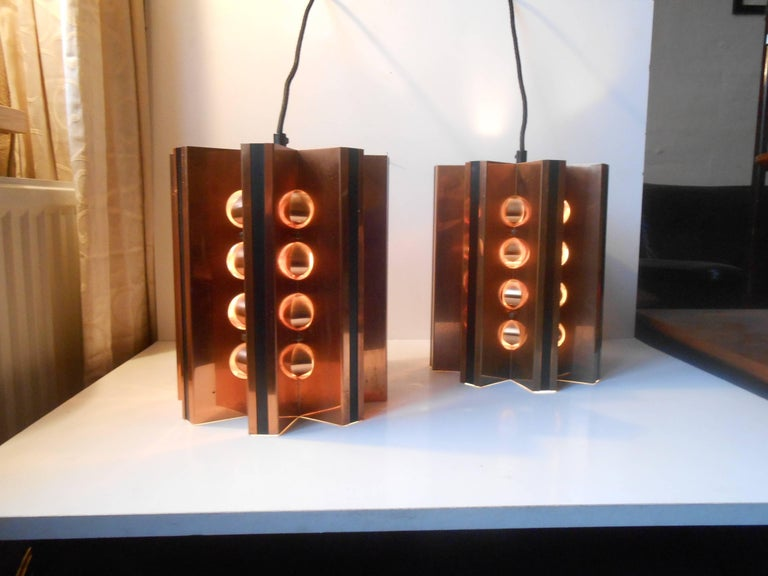 A pair of solid copper star shaped pendant lights by Danish Architect Werner Schou. Manufactured by Coronell in Denmark during the later part of the 1960s. Suitable for Brutalist and space age interiors. Splendid vintage condition with patina