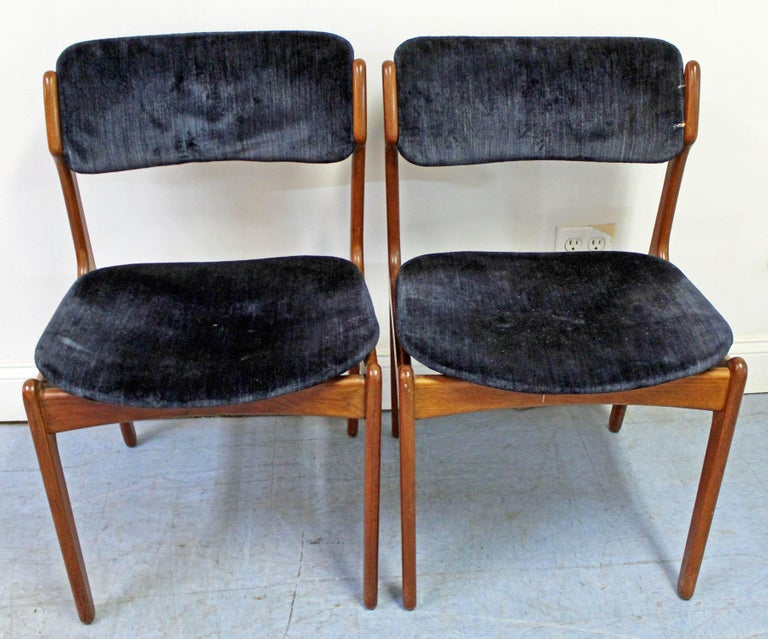 Offered is a pair of Danish modern Model 49 dining chairs by Erik Buch for O.D. Mobler. Includes two teak side chairs with elegant lines and floating seats with velvet-type upholstery. They're in decent vintage condition with normal age wear
