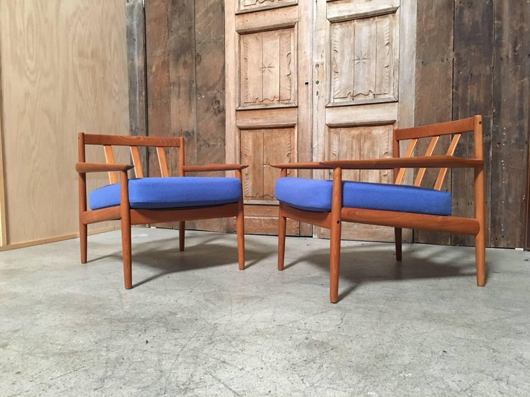 Solid teak armchairs with new fabric and foam by Arne Vodder.
