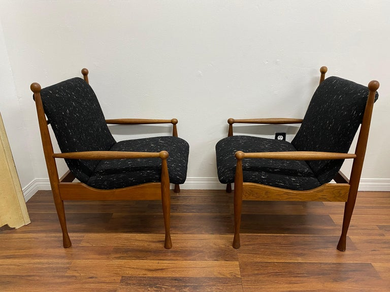 A pair of Danish teak armchairs, circa 1960s.Features a tweed upholstery. Great lines with excellent craftsmanship.