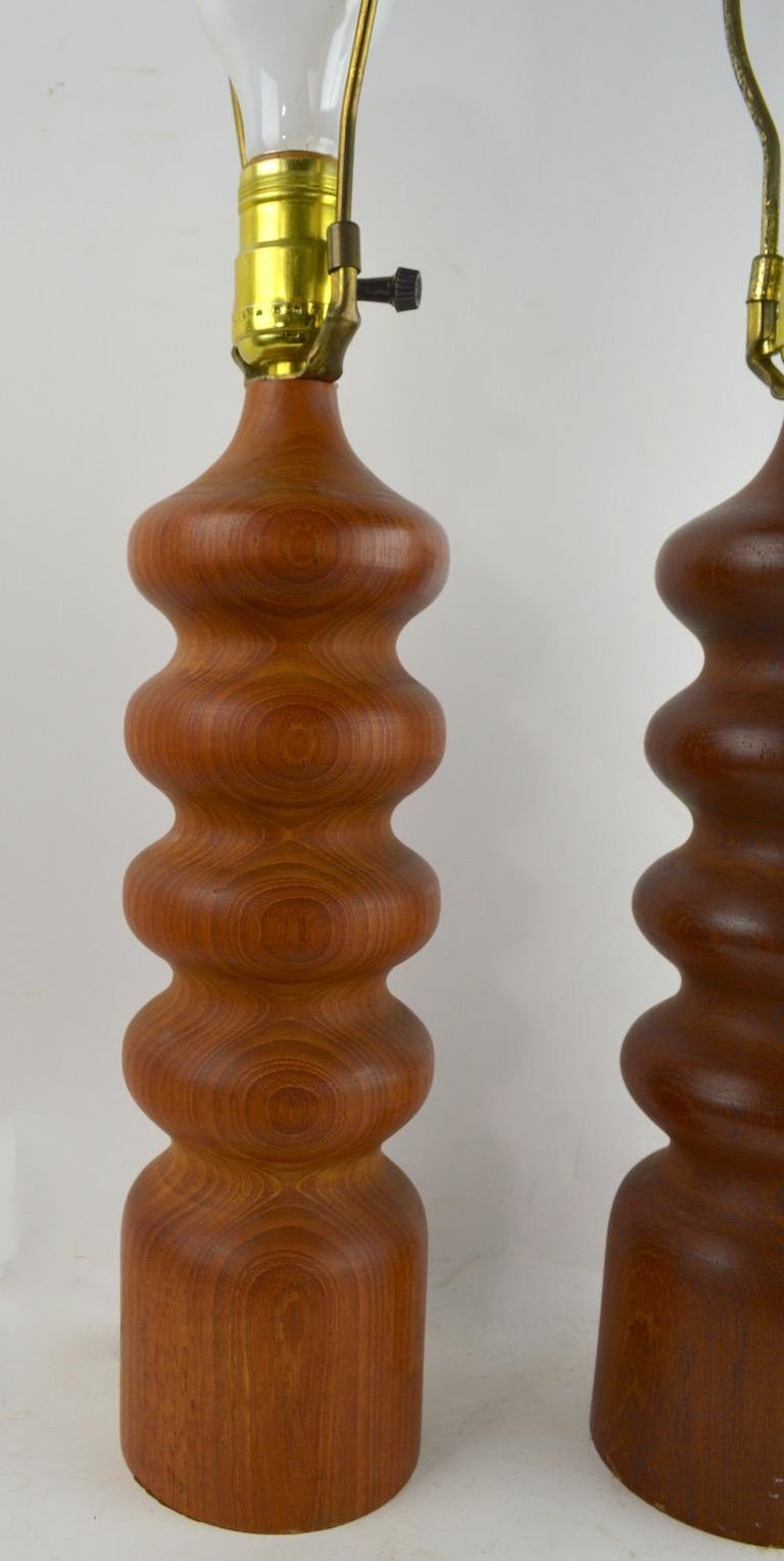 Scandinavian Modern Pair of Danish Modern Turned Teak Wood Table Lamps For Sale