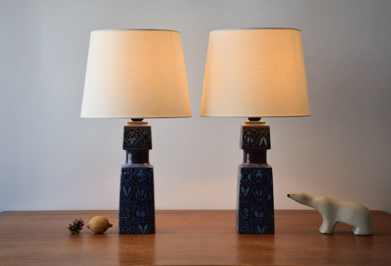Pair of table lamps designed by Nils Thorsson for Royal Copenhagen and Fog & Mørup and made, circa 1970s. They have a tactile abstract decor with black on dark blue. The lamps are the larger version of this series.  Included is a set of new