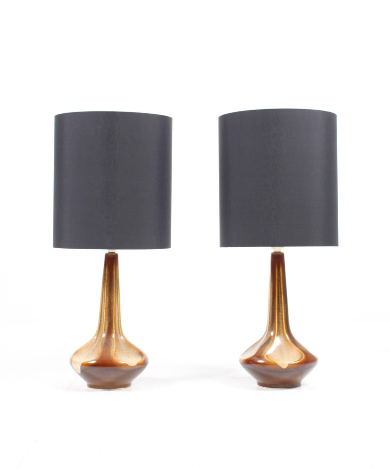 Pair of Danish table lamps designed by Søholm Studio in the mid-1960s. This lamp is a fine example of the Danish ceramics made on the island Bornholm. Great condition.