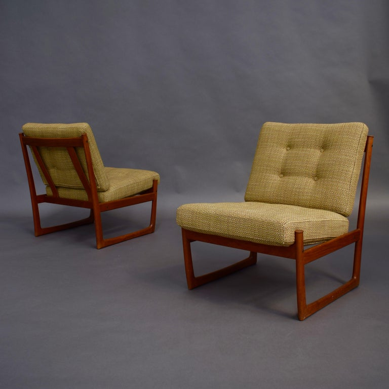 Gorgeous and sophisticated pair of lounge chairs model FD130 by Peter Hvidt / Orla Mølgaard-Nielsen for France and Son, Denmark, 1960s. Rare to find without armrests. This makes them even more beautiful. The cushions have been used for the new