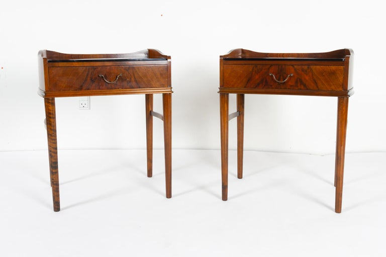 Pair of Danish walnut bedside tables, 1950s.