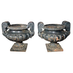 Pair of Dark Green/Black Painted Cast Iron Urns
