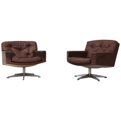 Pair of Rhône Dark Leather Swivel Lounge Chairs