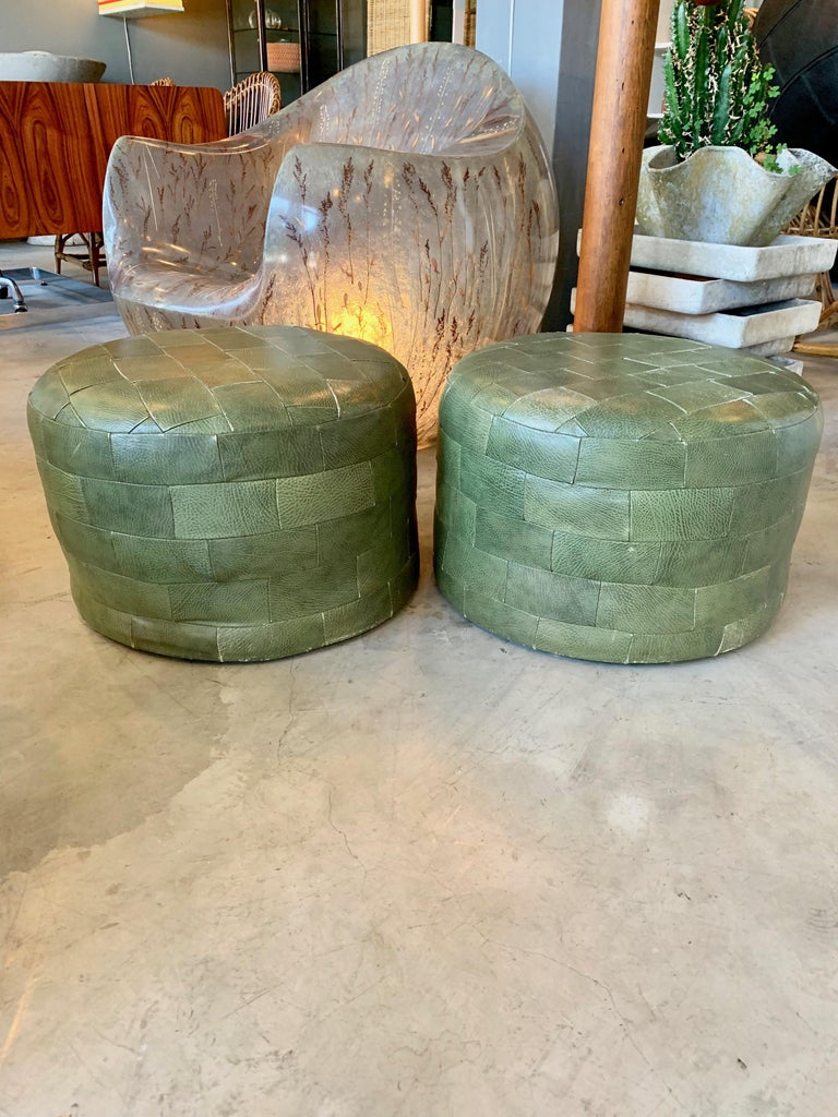 Gorgeous pair of patchwork olive leather ottomans by De Sede. Great coloring and patina to leather. Very good condition.  Priced as a pair.