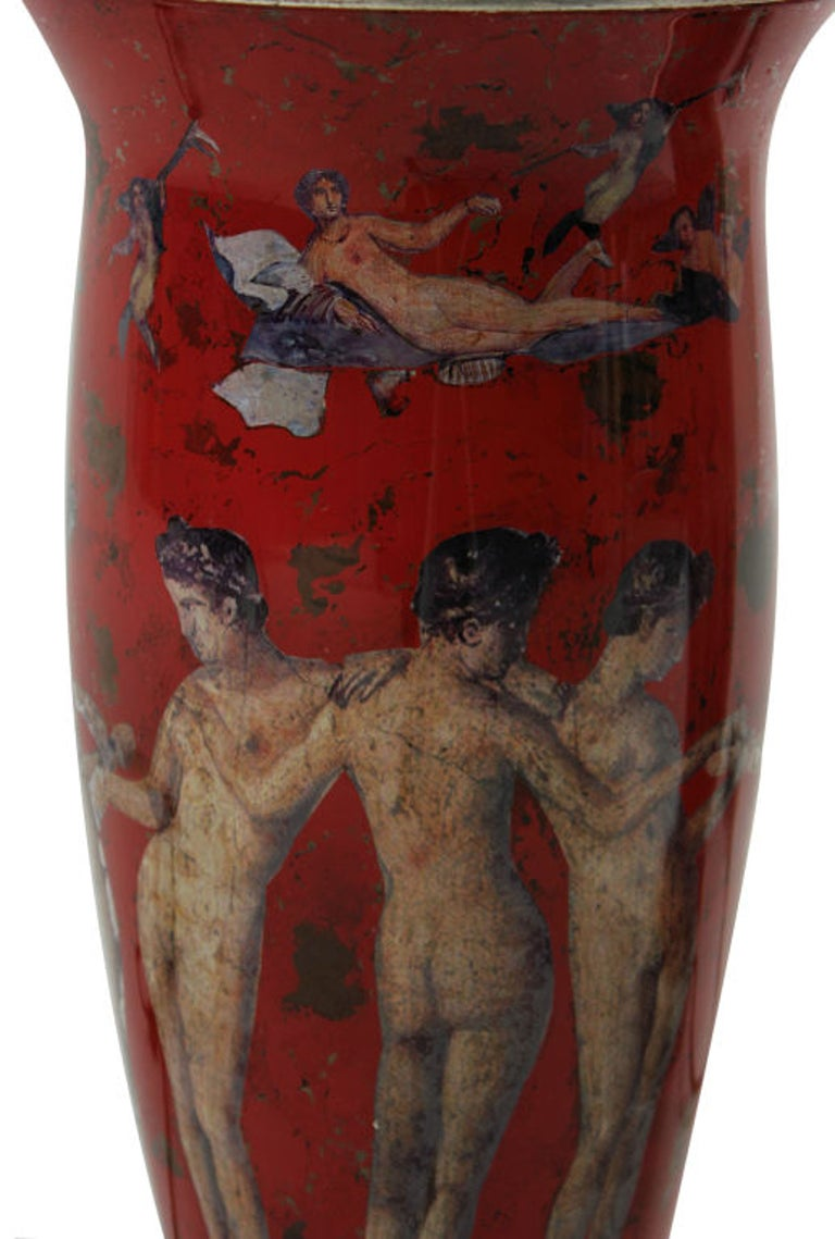 A pair of declamania hand painted table lamps depicting Pompeian scenes. With white gold leaf tops and bases.