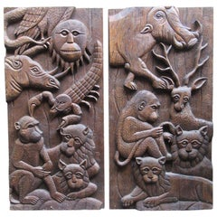 Pair of Decorative Carved Teak Wood Panels with Monkeys and Other Wild Animals