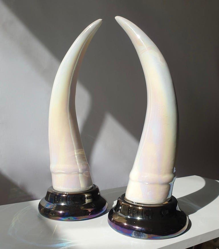 Elegant pair of 'Elephant Tusk' horn, made of iridescent ceramic, mounted on ceramic base.