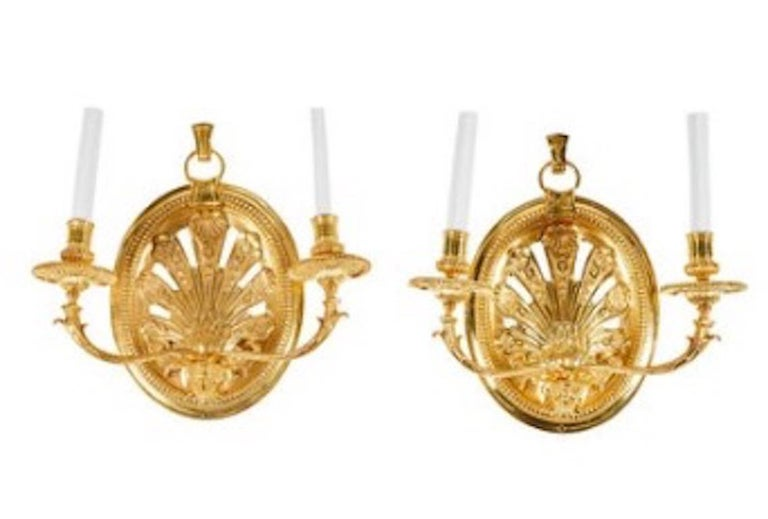 Pair of Delisle gold-plated chiseled sand casted bronze wall sconces.