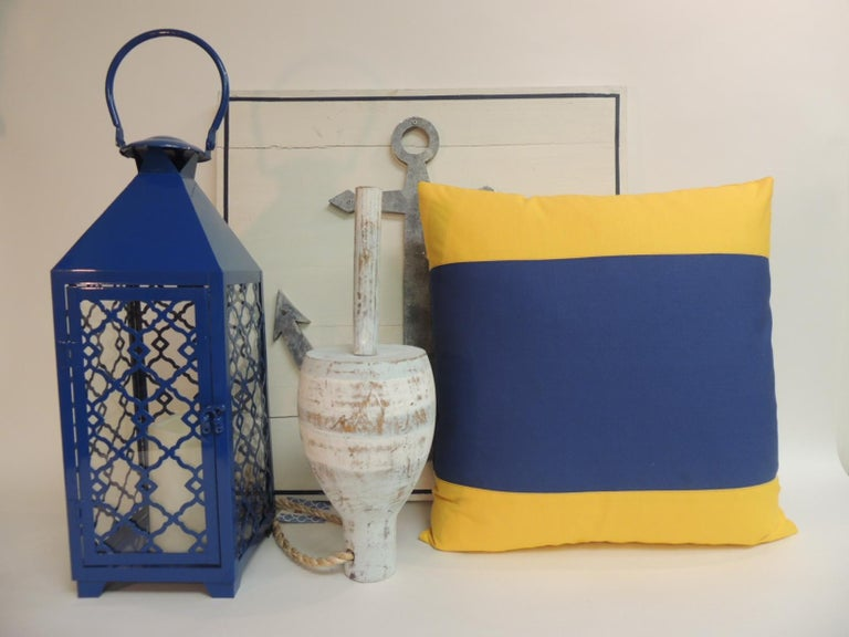 Yellow and blue nautical flag inspired square decorative pillows. Doubled sided, heavy cotton blue and yellow fabrics. Decorative pillows handcrafted and designed in the USA. Closure by stitch (no zipper closure) with custom made pillow