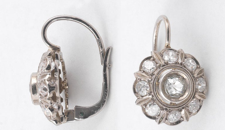 BERNARDO ANTICHITÀ, Ponte Vecchio, Florence Each designed as a cluster with the center claw set old cut diamond weighing approximately 0,50cts each, the eight stones in the outline weighing approx. 0.80 cts for each earring.  Total diamond weight: