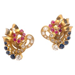 Pair of Diamond Ruby and Sapphire Earclips by Boucheron, Circa 1960
