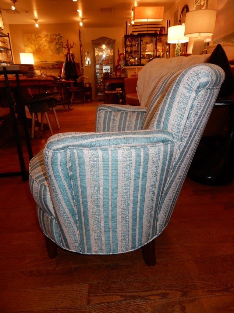 Pair of French Art Deco newly upholstered custom armchairs in a turquoise blue Lee sofa fabric. These chairs have a lot of weight to them (solid) and very comfortable. Immaculate condition, restored to new.