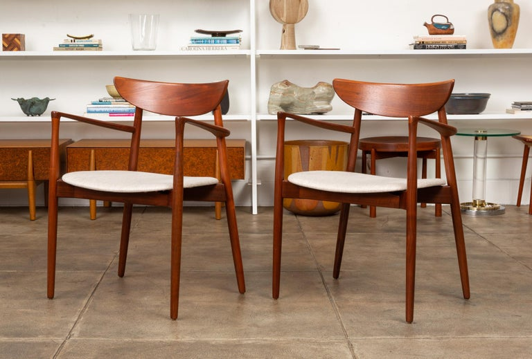 Set of two dining armchairs, designed circa 1960 by Harry Østergaard. Manufactured in Denmark by Randers Møbelfabrik, the chairs were imported, like many other Randers designs, by the Long Beach-based Moreddi for sale in their partner showroom,