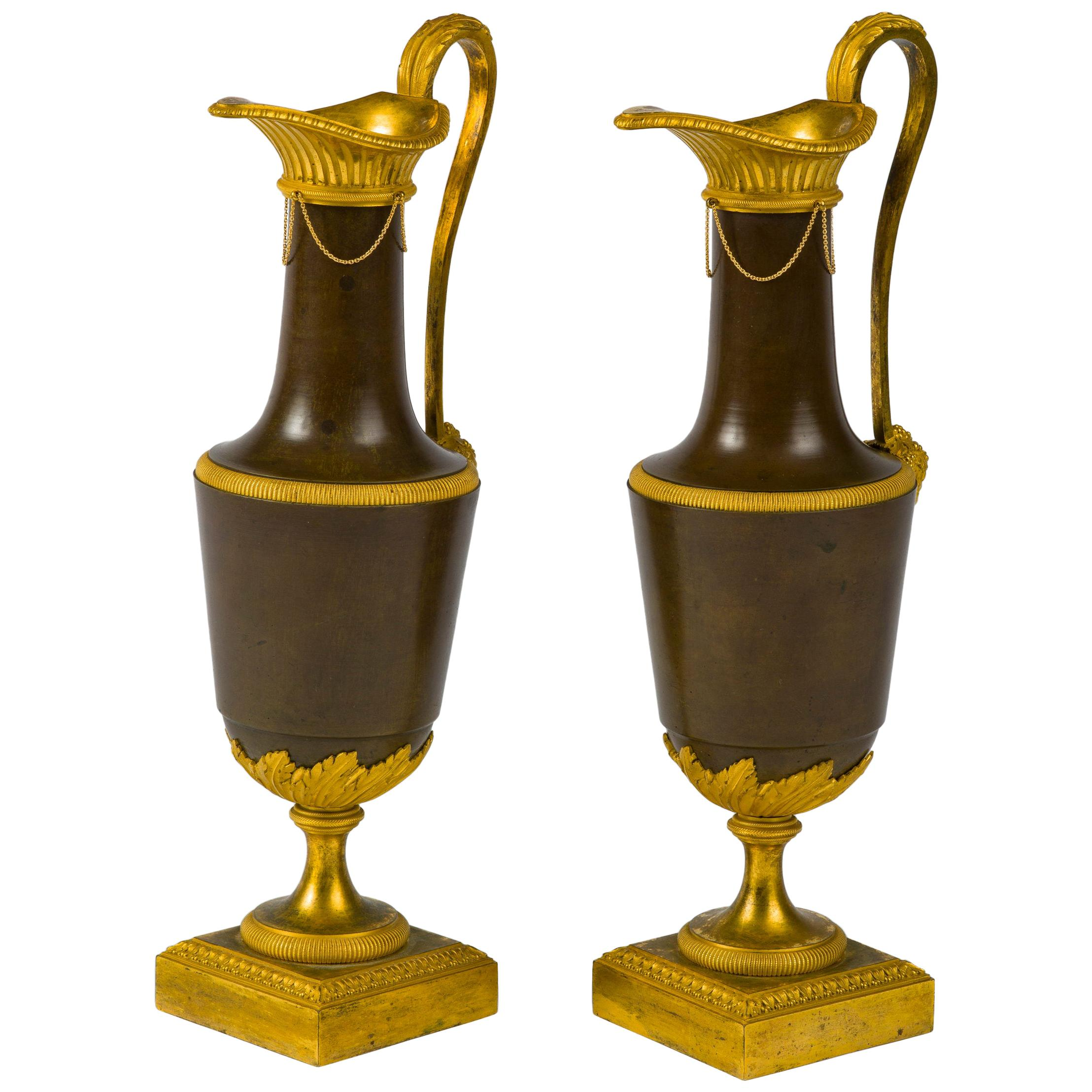 Pair of Directoire Gilt and Patinated Bronze Ewers