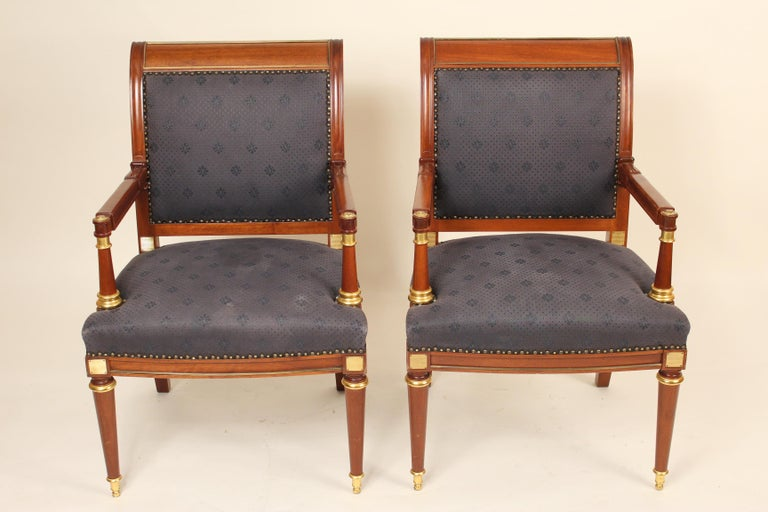 Pair of Directoire style mahogany armchairs with gilt bronze and gilt painted decoration, late 20th century.